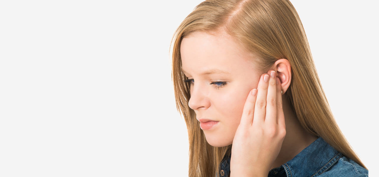 Woman Suffering From Tinnnitus