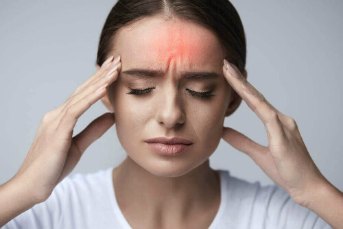 Woman looking anxious with a headache